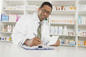 pharmacist writing on his notes