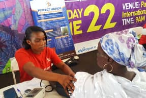 woman doing blood pressure test to another woman
