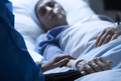 old woman on a hospital bed