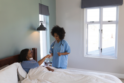 female nurse taking care of a patient at home