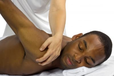 male patient getting physical therapy
