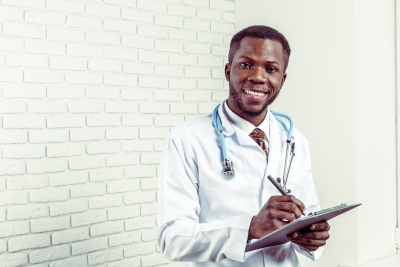 male doctor holding his pen and notes