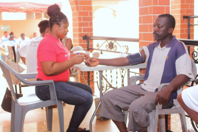 woman giving a blood pressure test to a man