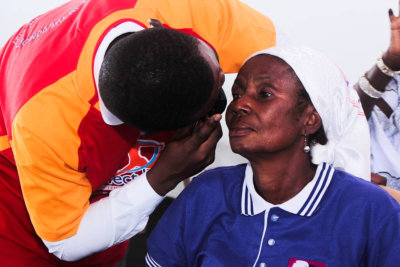 doctor looking at the woman's eye
