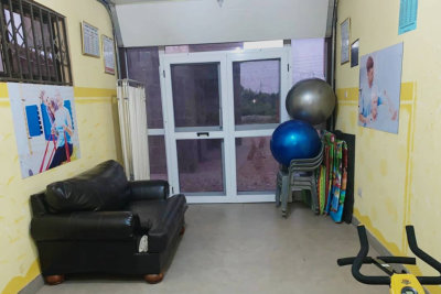 entrance door with balls and chair on the right side
