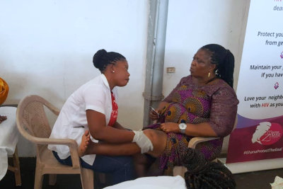 nurse touching the knee of the woman